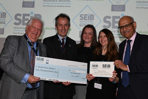 World-Horse-Welfare-receiving-their-cheque-L-to-R-Barry-Fehler-Roly-Owers-Suzy-Middleton-Emma-Williams-Bipin-Thaker
